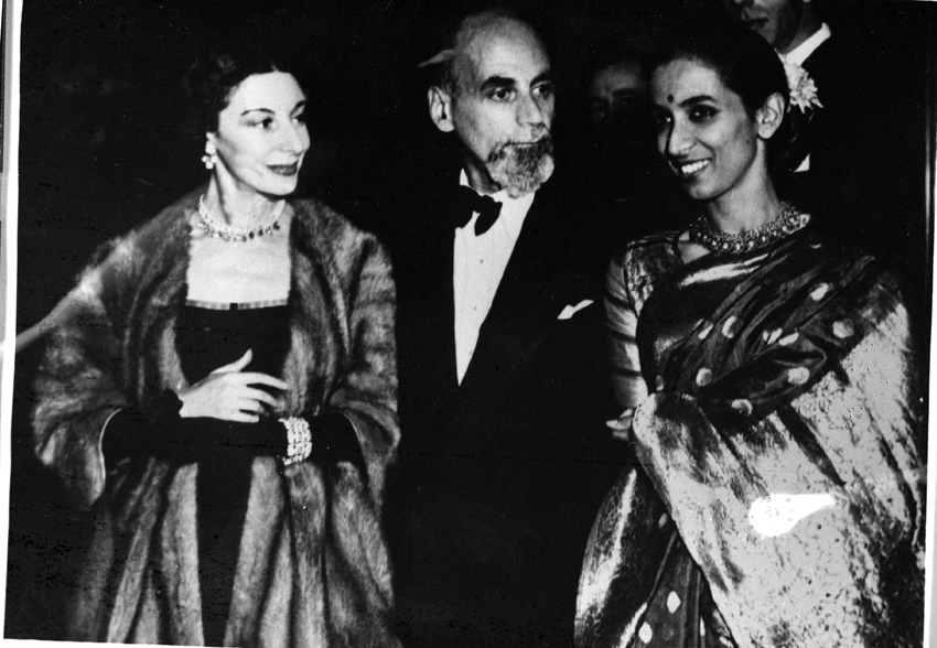 Ind. H.C. London/Nov.'51, A22a(iii) Photograph taken at the supper party held by the Indian High Commissioner at India House, on November 1,1951, in honour of Mrinalini Sarabhai during her season at the Cambridge Theatre in London. Mrinalini Sarabhai (right) is seen in the picture with Arnold Harkell, a celebrated critic and authority on ballet and Mme. Alicia Markova at the supper party.